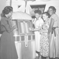 Women at the jukebox during a New Year's Eve part in Tallahassee, Florida