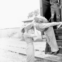 Beth Brown and Marine Corporal Travis Taylor kissing goodbye at the train depot in Tallahassee, Florida