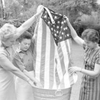 Women carefully washing flag for 4th of July celebration - Tallahassee