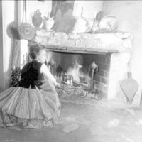 Reenactor beside the fireplace at the González-Alvarez House: St. Augustine, Florida