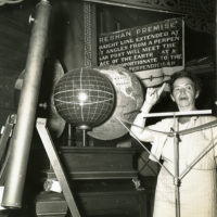 Koreshan Unity president Hedwig Michel with lecturing with globe
