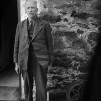 [The poet Robert Evans (Cybi), outside his home, Bryn Eithin, Llangybi]
