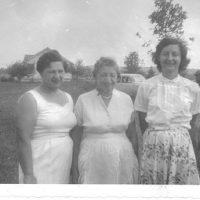 Three women near a field