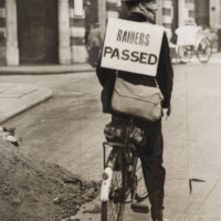 Special Constable carrying a 'Raiders Passed' sign, London